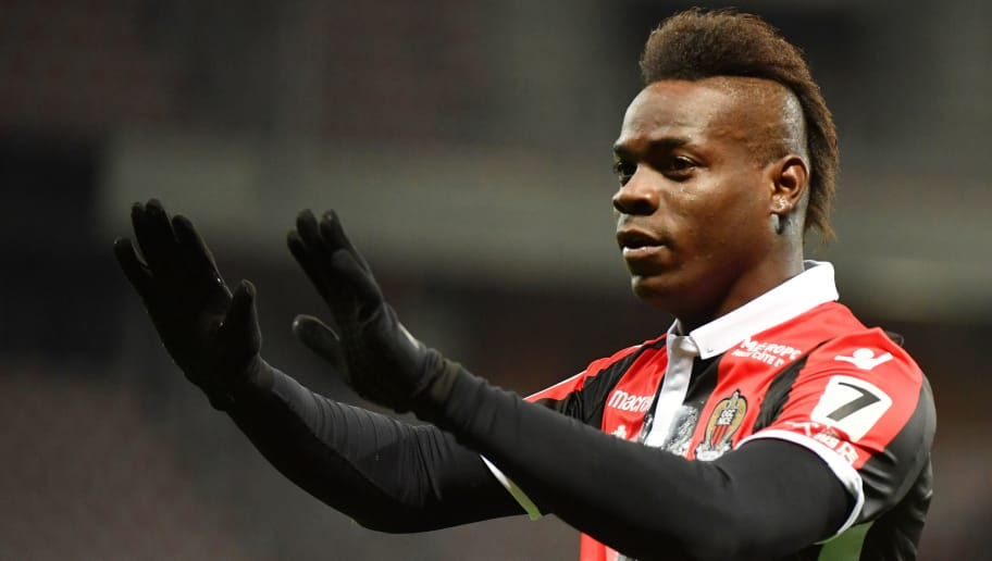 Nice's Italian forward Mario Balotelli celebrates after scoring a goal during the French L1 football match Nice (OGCN) vs Lille (LOSC) on March 2, 2018 at Allianz Riviera Stadium in Nice.  / AFP PHOTO / YANN COATSALIOU        (Photo credit should read YANN COATSALIOU/AFP/Getty Images)