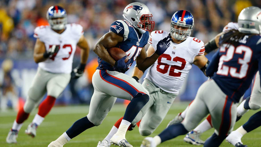 FOXBORO, MA - AUGUST 29: Steve Beauharnais #45 of the New England Patriots recovers a fumble in the second quarter against the New York Giants during the preseason game at Gillette Stadium on August 29, 2013 in Foxboro, Massachusetts. (Photo by Jared Wickerham/Getty Images)