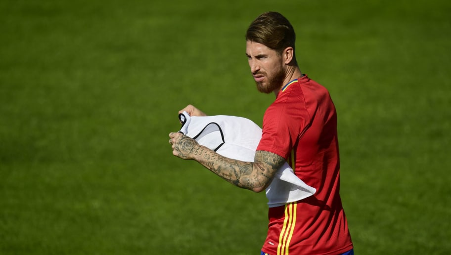 Spain's defender Sergio Ramos attends  a training session in Saint-Martin-de-Re, on June 24, 2016,  ahead of their Euro 2016 round of 16 football match against Italy. / AFP / PIERRE-PHILIPPE MARCOU        (Photo credit should read PIERRE-PHILIPPE MARCOU/AFP/Getty Images)