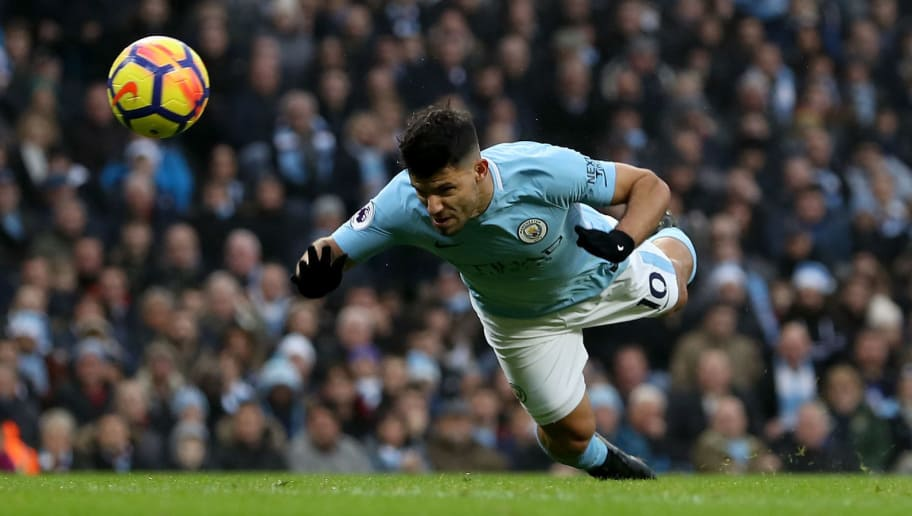 MANCHESTER, ENGLAND - DECEMBER 23: Sergio Aguero of Manchester City scores his sides first goal during the Premier League match between Manchester City and AFC Bournemouth at Etihad Stadium on December 23, 2017 in Manchester, England.  (Photo by Matthew Lewis/Getty Images)