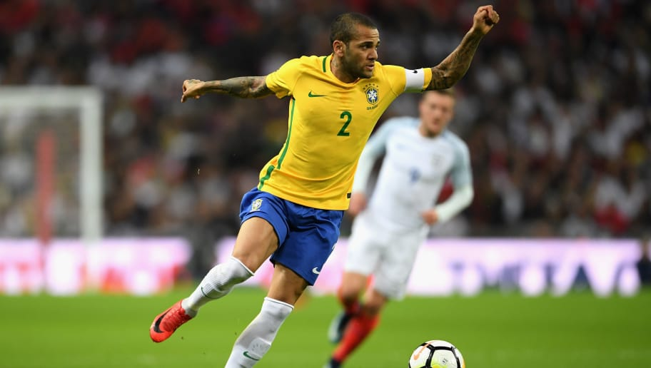 LONDON, ENGLAND - NOVEMBER 14: Dani Alves of Brazil in action during the international friendly match between England and Brazil at Wembley Stadium on November 14, 2017 in London, England.  (Photo by Laurence Griffiths/Getty Images)
