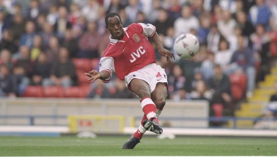 12 Oct 1996:  Ian Wright slots in Arsenal's first goal during the FA Carling Premier league match between Blackburn Rovers and Arsenal at Ewood Park in Blackburn. Arsenal went onto win the game by 0-2. Mandatory Credit: Shaun Botterill/Allsport