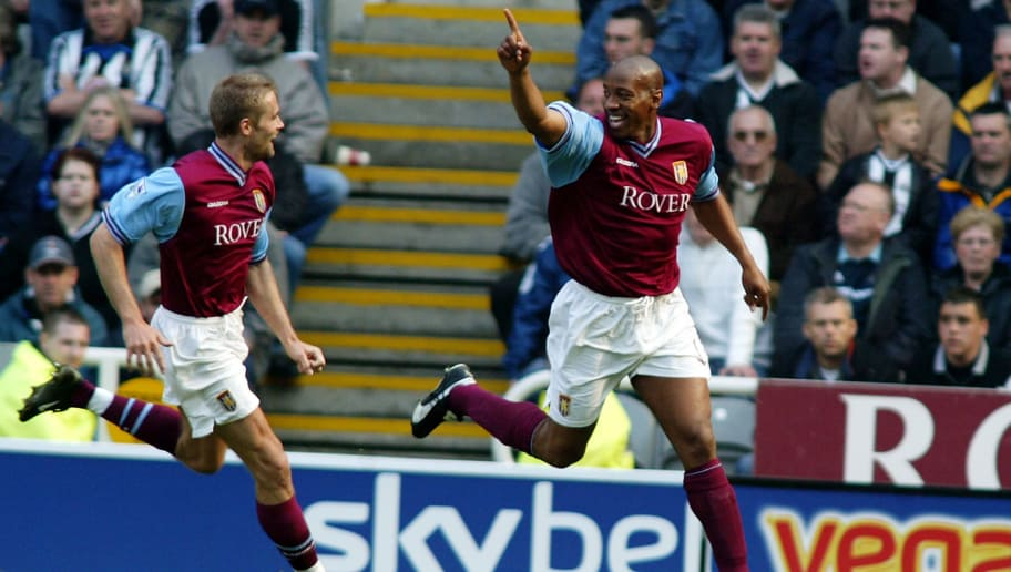 NEWCASTLE - APRIL 21:  Dion Dublin of Aston Villa celebrates scoring the equalising goal with team-mate Olof Mellberg during the FA Barclaycard Premiership match between Newcastle United and Aston Villa held on April 21, 2003 at St James' Park, in Newcastle, England. The match ended in a 1-1 draw. (Photo by Mike Finn-Kelcey/Getty Images)