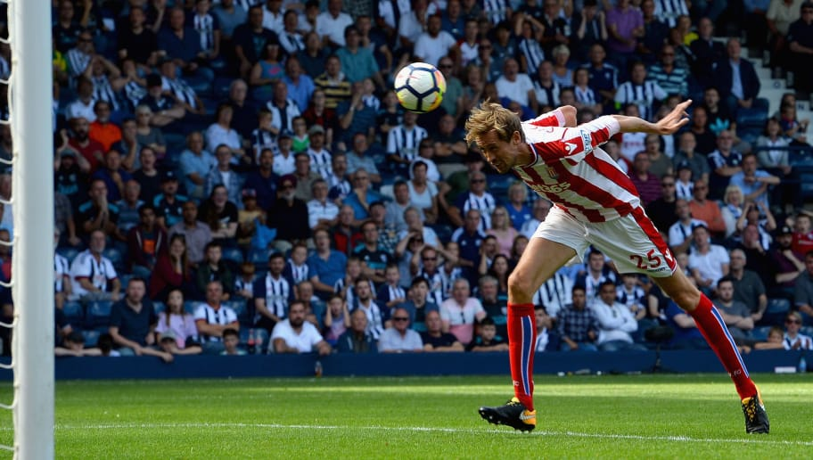 WEST BROMWICH, ENGLAND - AUGUST 27: Peter Crouch of Stoke City scores his sides first goal during the Premier League match between West Bromwich Albion and Stoke City at The Hawthorns on August 27, 2017 in West Bromwich, England.  (Photo by Tony Marshall/Getty Images)