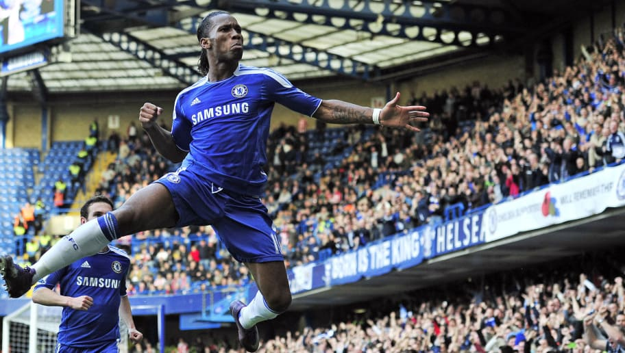 "Chelsea's Ivorian striker Didier Drogba celebrates scoring the opening goal of the English Premier League football match between Chelsea and Stoke City at Stamford Bridge in London, on March 10, 2012. AFP PHOTO/GLYN KIRK  RESTRICTED TO EDITORIAL USE. No use with unauthorized audio, video, data, fixture lists, club/league logos or ""live"" services. Online in-match use limited to 45 images, no video emulation. No use in betting, games or single club/league/player publications. (Photo credit should read GLYN KIRK/AFP/Getty Images)"