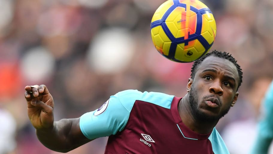 West Ham United's English midfielder Michail Antonio eyes the ball during the English Premier League football match between West Ham United and Burnley at The London Stadium, in east London on March 10, 2018. / AFP PHOTO / Ben STANSALL / RESTRICTED TO EDITORIAL USE. No use with unauthorized audio, video, data, fixture lists, club/league logos or 'live' services. Online in-match use limited to 75 images, no video emulation. No use in betting, games or single club/league/player publications.  /         (Photo credit should read BEN STANSALL/AFP/Getty Images)