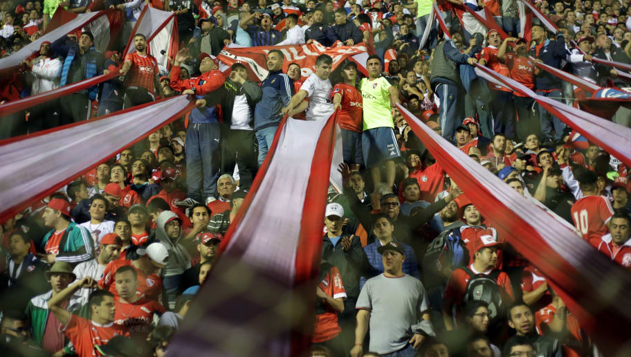 Independiente supporters cheer for their team during their Copa Sudamericana match against Atletico Tucuman at the Jose Fierro stadium in Tucuman, Argentina on August 22, 2017. / AFP PHOTO / Walter Monteros        (Photo credit should read WALTER MONTEROS/AFP/Getty Images)