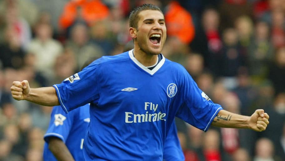 LONDON, UNITED KINGDOM:  Adrian Mutu of Chelsea celebrates scoring the opening goal against Arsenal during the F.A Cup fifth round match at Highbury in London 15 February 2004. AFP PHOTO Adrian DENNIS  (Photo credit should read ADRIAN DENNIS/AFP/Getty Images)