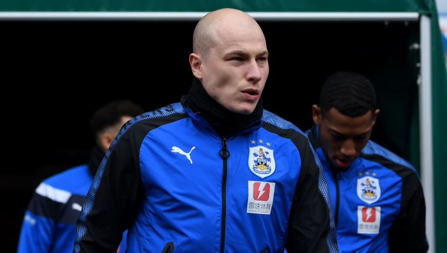 HUDDERSFIELD, ENGLAND - MARCH 10:  Aaron Mooy of Huddersfield Town walks out for the warm up prior to the Premier League match between Huddersfield Town and Swansea City at John Smith's Stadium on March 10, 2018 in Huddersfield, England.  (Photo by Gareth Copley/Getty Images)
