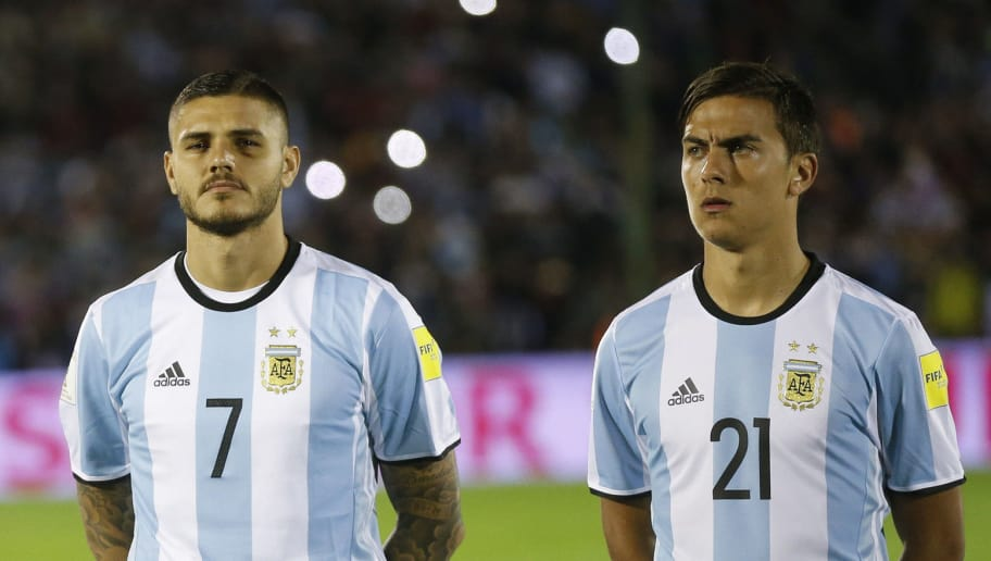 MONTEVIDEO, URUGUAY - AUGUST 31: (L-R) Nicolas Otamendi, Mauro Icardi and Paulo Dybala of Argentina line up for the National Anthem prior to a match between Uruguay and Argentina as part of FIFA 2018 World Cup Qualifiers at Centenario Stadium on August 31, 2017 in Montevideo, Uruguay. (Photo by Gabriel Rossi/Getty Images)