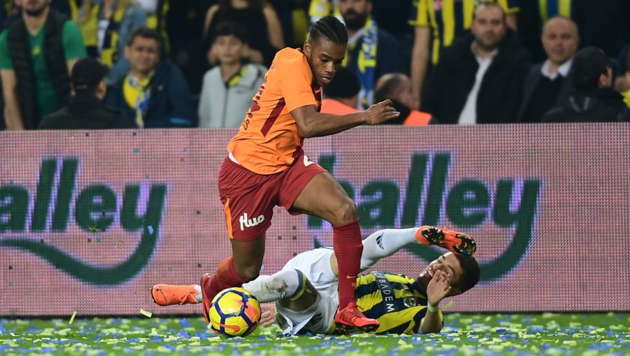 Galatasaray's Garry Rodrigues (L) vies for the ball with Fenerbahce's Russian defender Roman Neustaester (R) during the Turkish Super Lig football match between Fenerbahce and Galatasaray on March 17, 2018, at the Fenerbahce Ulker Stadium in Istanbul. / AFP PHOTO / OZAN KOSE        (Photo credit should read OZAN KOSE/AFP/Getty Images)