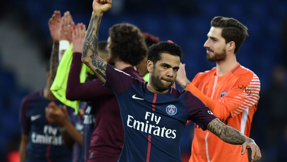 Paris Saint-Germain's Brazilian defender Dani Alves reacts at the end of the French Ligue 1 football match between Paris Saint-Germain and Angers at the Parc des Princes stadium in Paris on March 14, 2018.    / AFP PHOTO / FRANCK FIFE        (Photo credit should read FRANCK FIFE/AFP/Getty Images)