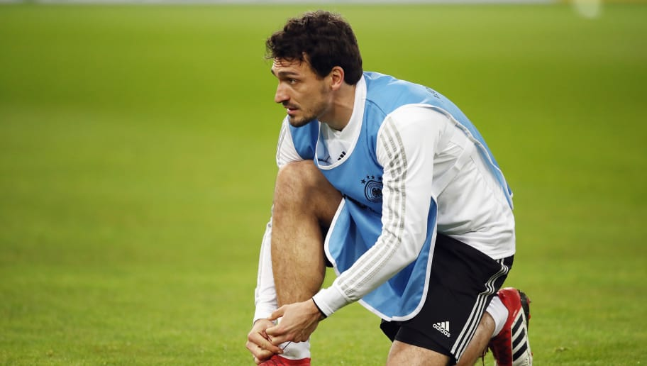 DUESSELDORF, GERMANY - MARCH 22: Mats Hummels ties his boots during a Germany training session ahead of their international friendly match against Spain at ESPRIT arena on March 22, 2018 in Duesseldorf, Germany.  (Photo by Maja Hitij/Bongarts/Getty Images)