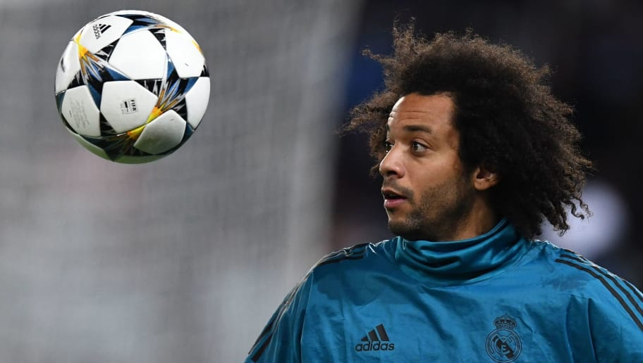 Real Madrid's Brazilian defender Marcelo warms up prior to the UEFA Champions League round of 16 second leg football match between Paris Saint-Germain (PSG) and Real Madrid on March 6, 2018, at the Parc des Princes stadium in Paris. / AFP PHOTO / FRANCK FIFE        (Photo credit should read FRANCK FIFE/AFP/Getty Images)
