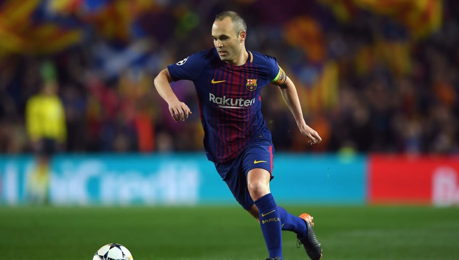 BARCELONA, SPAIN - MARCH 14:  Andres Iniesta of Barcelona runs with the ball during the UEFA Champions League Round of 16 Second Leg match FC Barcelona and Chelsea FC at Camp Nou on March 14, 2018 in Barcelona, Spain.  (Photo by Shaun Botterill/Getty Images)