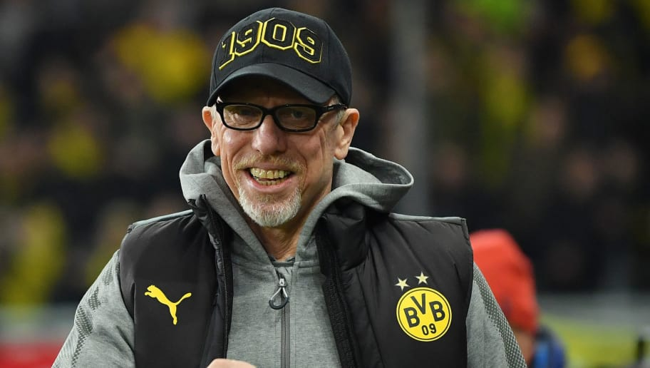 SALZBURG, AUSTRIA - MARCH 15: Head coach Peter Stoeger of Dortmund smiles prior to the UEFA Europa League Round of 16, 2nd leg match between FC Red Bull Salzburg and Borussia Dortmund at the Red Bull Arena on March 15, 2018 in Salzburg, Austria. (Photo by Sebastian Widmann/Bongarts/Getty Images,)