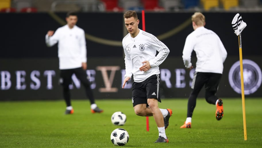 DUESSELDORF, GERMANY - MARCH 22: Joshua Kimmich controls the ball during a Germany training session ahead of their international friendly match against Spain at ESPRIT arena on March 22, 2018 in Duesseldorf, Germany. (Photo by Maja Hitij/Bongarts/Getty Images)