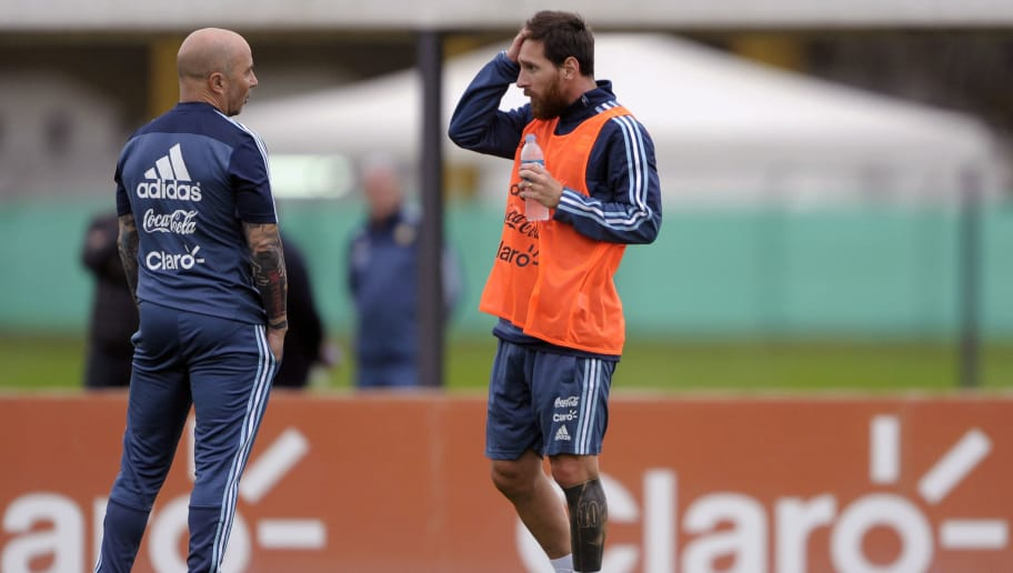 Argentina's forward Lionel Messi (R) talks with his coach Jorge Sampaoli during a training session in Ezeiza, Buenos Aires on August 28, 2017, ahead of a 2018 FIFA World Cup Russia South American qualifier football match against Uruguay to be held in Montevideo on August 31.  / AFP PHOTO / ALEJANDRO PAGNI        (Photo credit should read ALEJANDRO PAGNI/AFP/Getty Images)