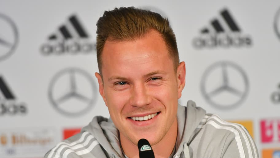 Marc-Andre Ter Stegen, goalkeeper of the German national football team, smiles during a press conference on the eve of the team's international friendly match against Spain on March 22, 2018 in Duesseldorf, western Germany. / AFP PHOTO / Patrik STOLLARZ        (Photo credit should read PATRIK STOLLARZ/AFP/Getty Images)