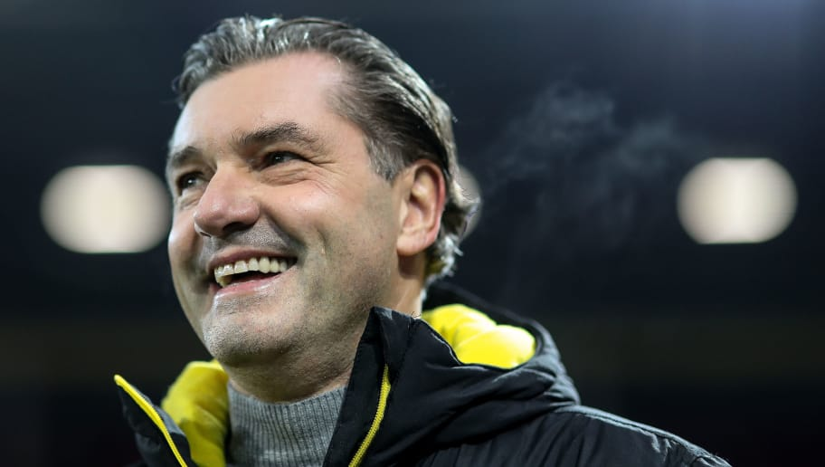 MAINZ, GERMANY - DECEMBER 12: Manager Michael Zorc of Dortmund smiles prior the Bundesliga match between 1. FSV Mainz 05 and Borussia Dortmund at Opel Arena on December 12, 2017 in Mainz, Germany. (Photo by Simon Hofmann/Bongarts/Getty Images )