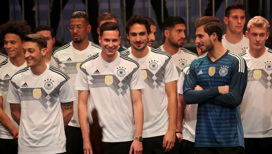 BERLIN, GERMANY - NOVEMBER 07:  Members of the German national football team gather on the stage at the presentation of the 2018 FIFA World Cup Russia Adidas jersey at The Base on November 7, 2017 in Berlin, Germany.  (Photo by Boris Streubel/Getty Images For Adidas)