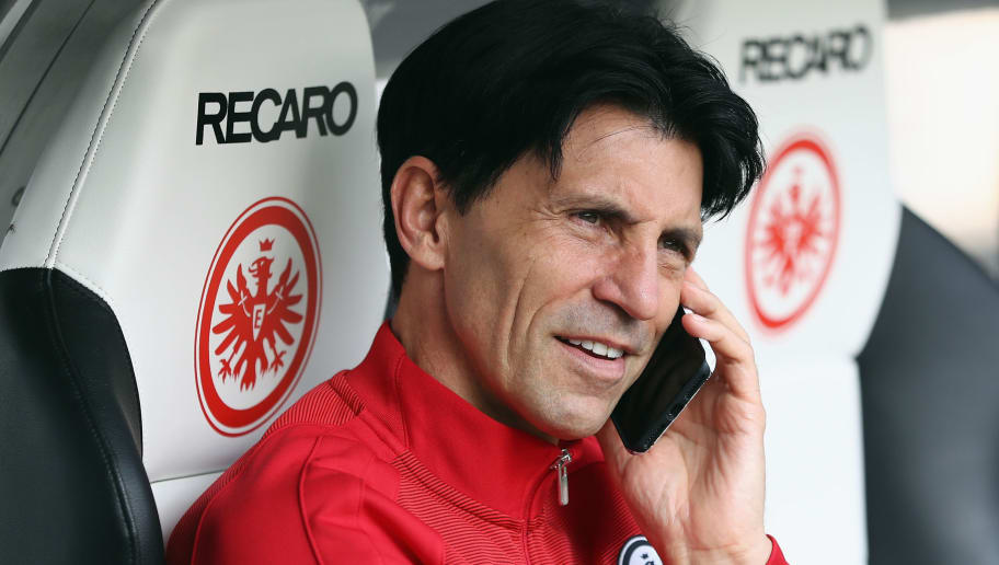 FRANKFURT AM MAIN, GERMANY - APRIL 01: Manager Bruno Huebner of Frankfurt talks on the phone prior to the Bundesliga match between Eintracht Frankfurt and Borussia Moenchengladbach at Commerzbank-Arena on April 1, 2017 in Frankfurt am Main, Germany.  (Photo by Alex Grimm/Bongarts/Getty Images)