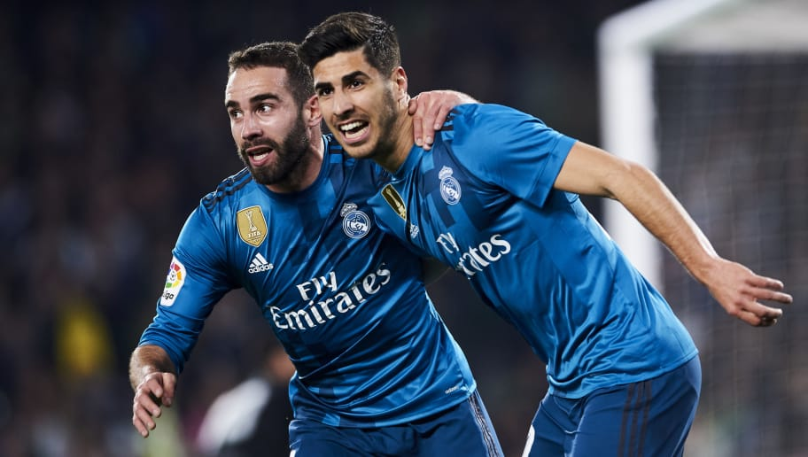 SEVILLE, SPAIN - FEBRUARY 18:  Marco Asensio of Real Madrid celebrates with his teammates Daniel Carvajal of Real Madrid after scoring his team's third goal during the La Liga match between Real Betis and Real Madrid at Benito Villamrin stadium on February 18, 2018 in Seville, Spain.  (Photo by Aitor Alcalde/Getty Images)