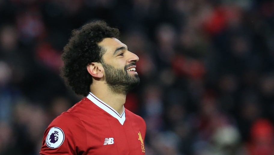 Liverpool's Egyptian midfielder Mohamed Salah celebrates, scoring the team's second goal during the English Premier League football match between Liverpool and Watford at Anfield in Liverpool, north west England on March 17, 2018. / AFP PHOTO / Lindsey PARNABY / RESTRICTED TO EDITORIAL USE. No use with unauthorized audio, video, data, fixture lists, club/league logos or 'live' services. Online in-match use limited to 75 images, no video emulation. No use in betting, games or single club/league/player publications.  /         (Photo credit should read LINDSEY PARNABY/AFP/Getty Images)
