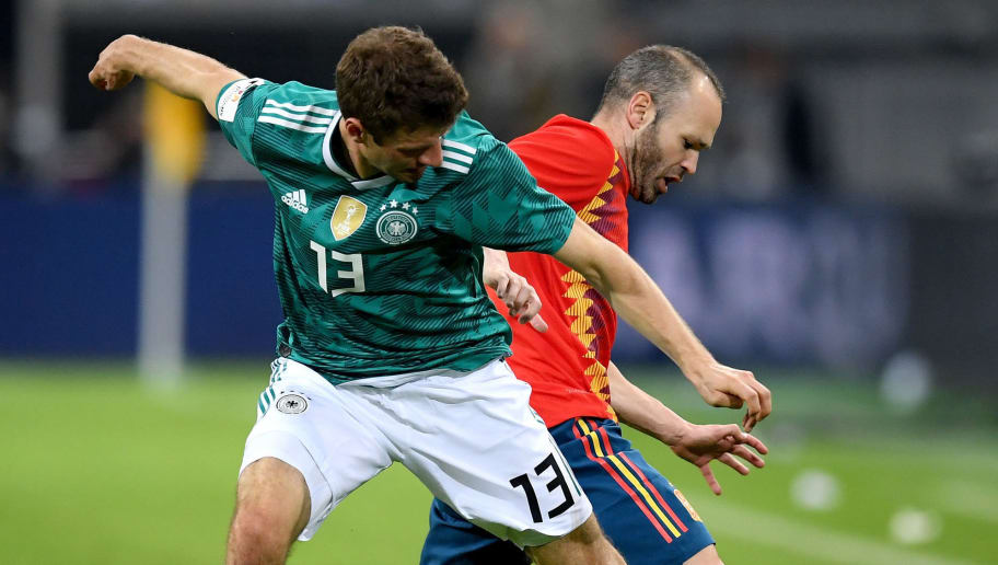 DUESSELDORF, GERMANY - MARCH 23:  Andreas Iniesta of Spain is challenged by Thomas Mueller of Germany during the International friendly match between Germany and Spain at Esprit-Arena on March 23, 2018 in Duesseldorf, Germany.  (Photo by Matthias Hangst/Bongarts/Getty Images)