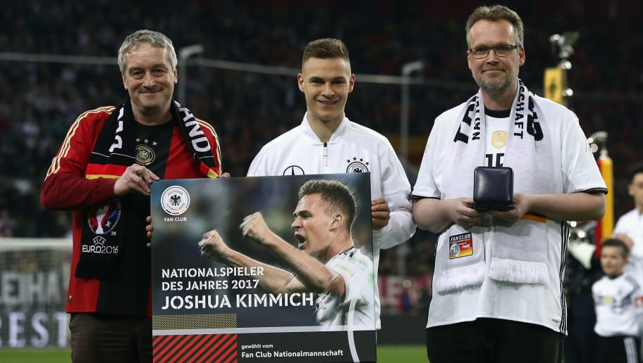 DUESSELDORF, GERMANY - MARCH 23: Joshua Kimmich is awarded 'National team player of the year' by the Fan Club National Team during the international friendly match between Germany and Spain at Esprit-Arena on March 23, 2018 in Duesseldorf, Germany.  (Photo by Alex Grimm/Bongarts/Getty Images)