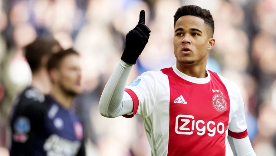 Ajax Amsterdam's midfielder Justin Kluivert reacts after opening the scoring during the Dutch Eredivisie soccer match between Ajax Amsterdam and FC Twente Enschede, in Amsterdam on February 11, 2018.  / AFP PHOTO / ANP / Olaf KRAAK / Netherlands OUT        (Photo credit should read OLAF KRAAK/AFP/Getty Images)
