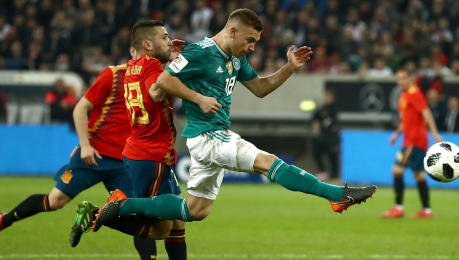 DUESSELDORF, GERMANY - MARCH 23: Joshua Kimmich of Germany shoots during the International friendly match between Germany and Spain at Esprit-Arena on March 23, 2018 in Duesseldorf, Germany.  (Photo by Lars Baron/Bongarts/Getty Images)