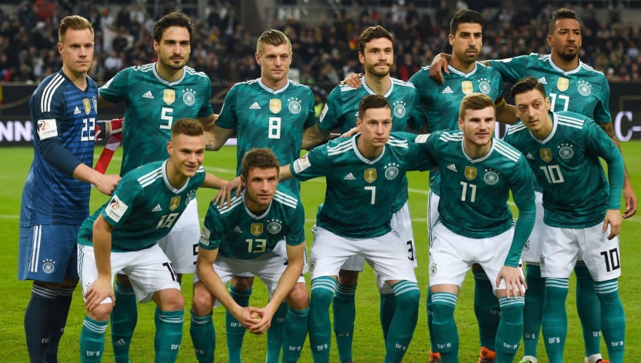 Germany's players pose for a team photo prior to the international friendly football match of Germany vs Spain in Duesseldorf, western Germany, on March 23, 2018, in preparation of the 2018 Fifa World Cup: (front row, L-R) Germany's midfielder Joshua Kimmich, Germany's forward Thomas Mueller, Germany's midfielder Julian Draxler, Germany's striker Timo Werner and Germany's midfielder Mesut Ozil; (row behind, L-R) Germany's midfielder Leroy Sane, Germany's defender Mats Hummels, Germany's midfielder Toni Kroos, Germany's defender Jonas Hector, Germany's midfielder Sami Khedira and Germany's defender Jerome Boateng. / AFP PHOTO / Patrik STOLLARZ        (Photo credit should read PATRIK STOLLARZ/AFP/Getty Images)