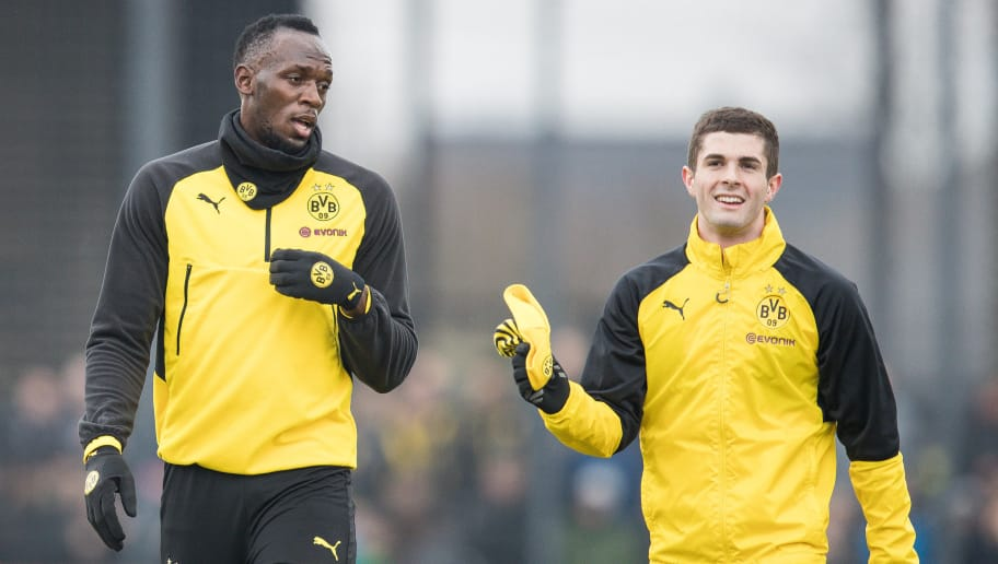 DORTMUND, GERMANY - MARCH 23: Usain Bolt talks to Christian Pulisic #22 of Borussia Dortmund during a training of Borussia Dortmund on March 23, 2018 in Dortmund, Germany. (Photo by Maja Hitij/Bongarts/Getty Images)