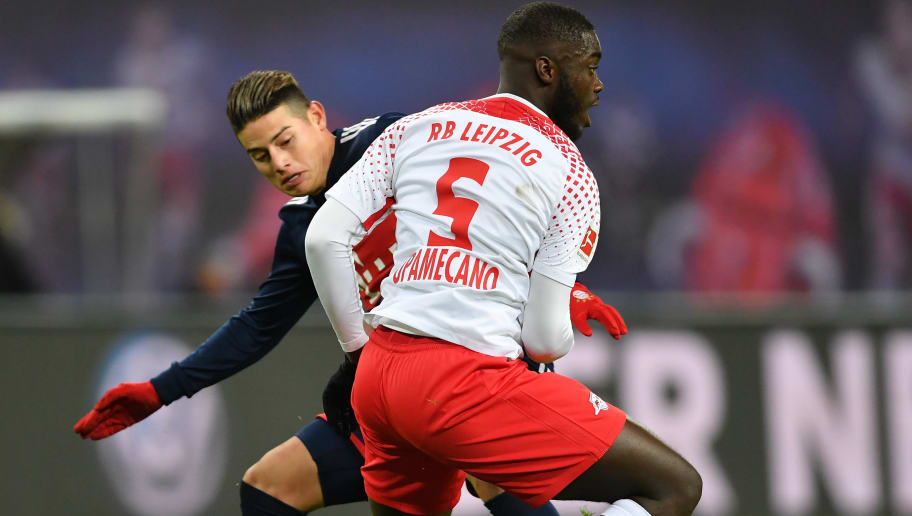 LEIPZIG, GERMANY - MARCH 18:  James Rodr'guez of Bayern is challenged by Dayot Upamecano of Leipzig during the Bundesliga match between RB Leipzig and FC Bayern Muenchen at Red Bull Arena on March 18, 2018 in Leipzig, Germany.  (Photo by Stuart Franklin/Bongarts/Getty Images)