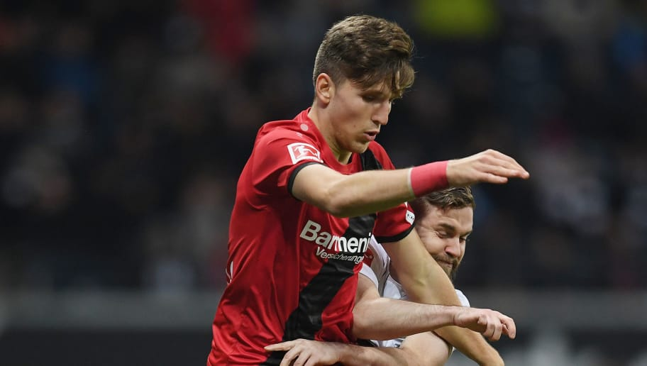 FRANKFURT AM MAIN, GERMANY - NOVEMBER 25: Panagiotis Retsos of Leverkusen and Marc Stendera of Frankfurt compete for the ball during the Bundesliga match between Eintracht Frankfurt and Bayer 04 Leverkusen at Commerzbank-Arena on November 25, 2017 in Frankfurt am Main, Germany. (Photo by Matthias Hangst/Bongarts/Getty Images)