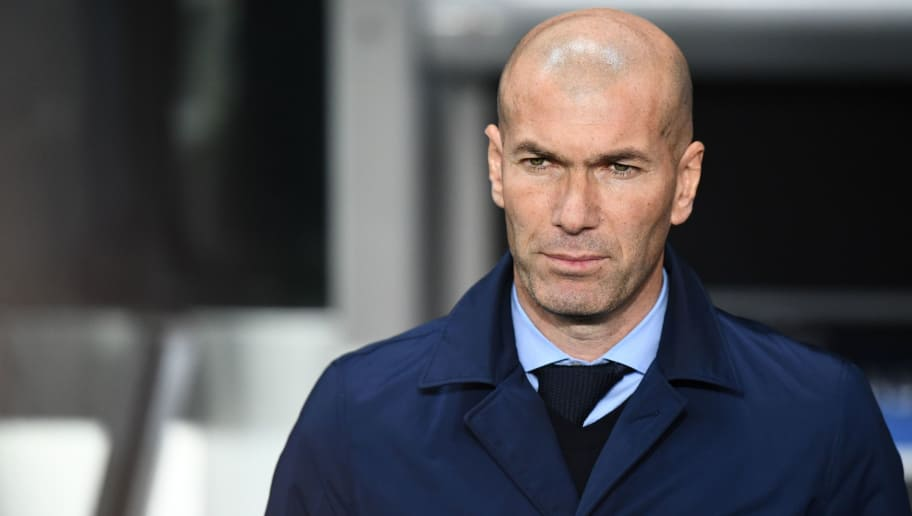 Real Madrid's French coach Zinedine Zidane reacts  during the UEFA Champions League round of 16 second leg football match between Paris Saint-Germain (PSG) and Real Madrid on March 6, 2018, at the Parc des Princes stadium in Paris. / AFP PHOTO / FRANCK FIFE        (Photo credit should read FRANCK FIFE/AFP/Getty Images)