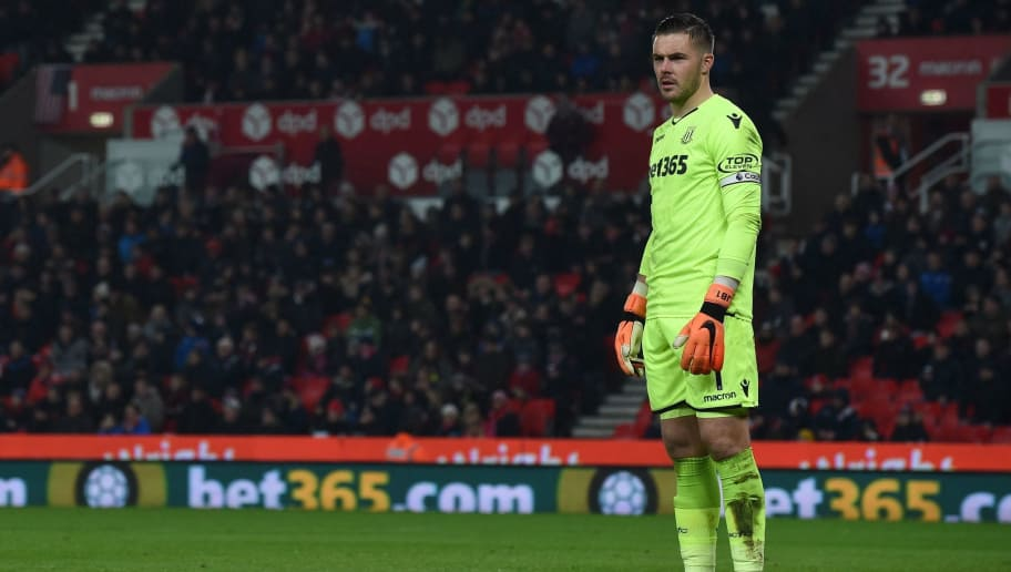Stoke City's English goalkeeper Jack Butland looks on during the English Premier League football match between Stoke City and Manchester City at the Bet365 Stadium in Stoke-on-Trent, central England on March 12, 2018. / AFP PHOTO / PAUL ELLIS / RESTRICTED TO EDITORIAL USE. No use with unauthorized audio, video, data, fixture lists, club/league logos or 'live' services. Online in-match use limited to 75 images, no video emulation. No use in betting, games or single club/league/player publications.  /         (Photo credit should read PAUL ELLIS/AFP/Getty Images)