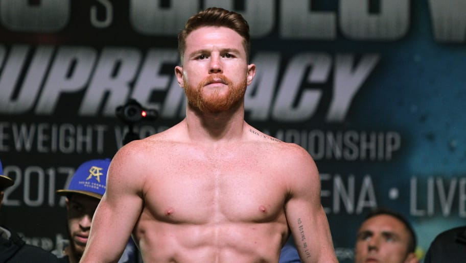 Boxer Canelo Alvarez poses on the scales during a weigh-in with Gennady Golovkin at the MGM Grand Hotel & Casino on September 15, 2017 in Las Vegas, Nevada. Alvarez will challenge WBC, WBA and IBF middleweight champion Gennady Golovkin for his titles at T-Mobile Arena on September 16 in Las Vegas. / AFP PHOTO / John GURZINSKI        (Photo credit should read JOHN GURZINSKI/AFP/Getty Images)