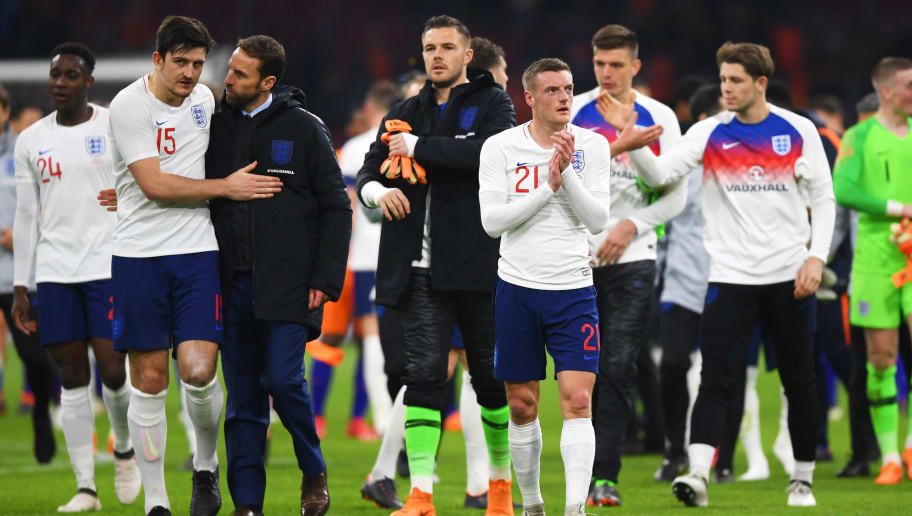 AMSTERDAM, NETHERLANDS - MARCH 23:  Harry Maguire, Gareth Southgate manager of England and Jamie Vardy salute the travelling fans after the international friendly match between Netherlands and England at Johan Cruyff Arena on March 23, 2018 in Amsterdam, Netherlands.  (Photo by Shaun Botterill/Getty Images)