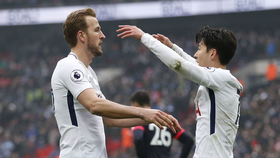 Tottenham Hotspur's South Korean striker Son Heung-Min (R) celebrates with Tottenham Hotspur's English striker Harry Kane as he scores the team's second goal during the English Premier League football match between Tottenham Hotspur and Huddersfield at Wembley Stadium in London, on March 3, 2018. / AFP PHOTO / Ian KINGTON / RESTRICTED TO EDITORIAL USE. No use with unauthorized audio, video, data, fixture lists, club/league logos or 'live' services. Online in-match use limited to 75 images, no video emulation. No use in betting, games or single club/league/player publications.  /         (Photo credit should read IAN KINGTON/AFP/Getty Images)