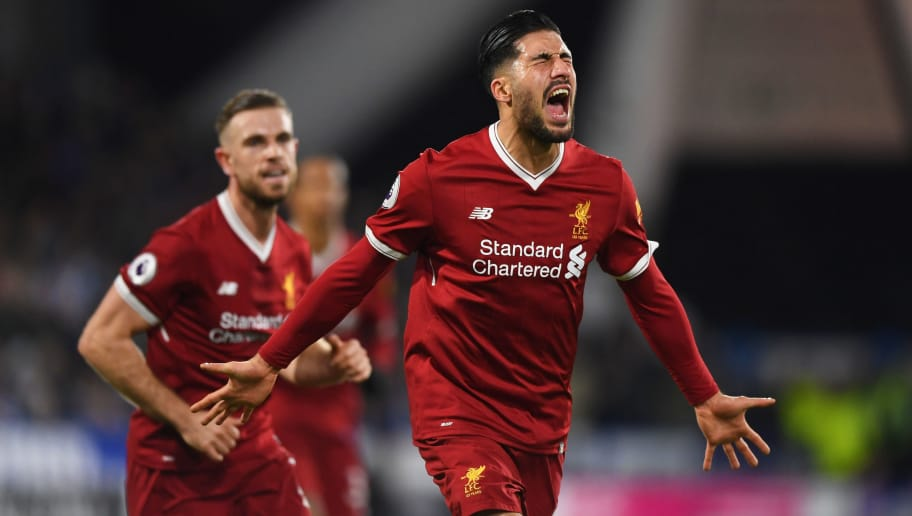 HUDDERSFIELD, ENGLAND - JANUARY 30:  Emre Can of Liverpool (R) celebrates as he scores their first goal with Jordan Henderson during the Premier League match between Huddersfield Town and Liverpool at John Smith's Stadium on January 30, 2018 in Huddersfield, England.  (Photo by Gareth Copley/Getty Images)
