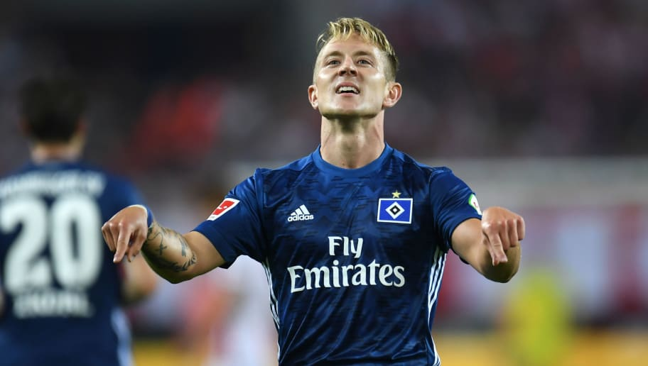Hamburg's midfielder Lewis Holtby celebrates scoring during the German first division Bundesliga football match 1 FC Cologne v Hamburg SV in Cologne, western Germany, on August 25, 2017. / AFP PHOTO / PATRIK STOLLARZ        (Photo credit should read PATRIK STOLLARZ/AFP/Getty Images)