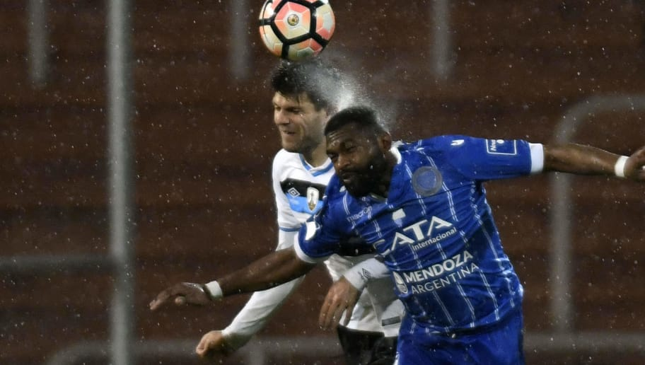 Brazil's Gremio Walter Kannemann (L) vies for the ball with Argentina's Godoy Cruz Santiago Garcia during their Copa Libertadores 2017 second round first leg football match at Malvinas Argentinas stadium in Mendoza, Argentina, on July 4, 2017. / AFP PHOTO / Andres Larrovere        (Photo credit should read ANDRES LARROVERE/AFP/Getty Images)