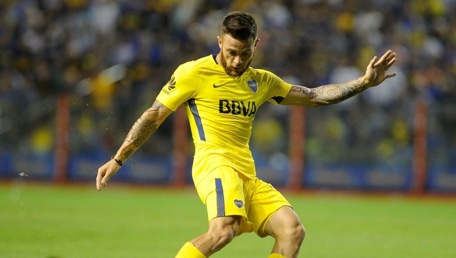 Uruguayan Boca Juniors's midfielder Nahitan Nandez strikes the ball during the Argentina First Division Superliga football match against Tigre at the Alberto J. Armando 'La Bombonera' stadium, in Buenos Aires, on March 10, 2018. / AFP PHOTO / JAVIER GONZALEZ TOLEDO        (Photo credit should read JAVIER GONZALEZ TOLEDO/AFP/Getty Images)