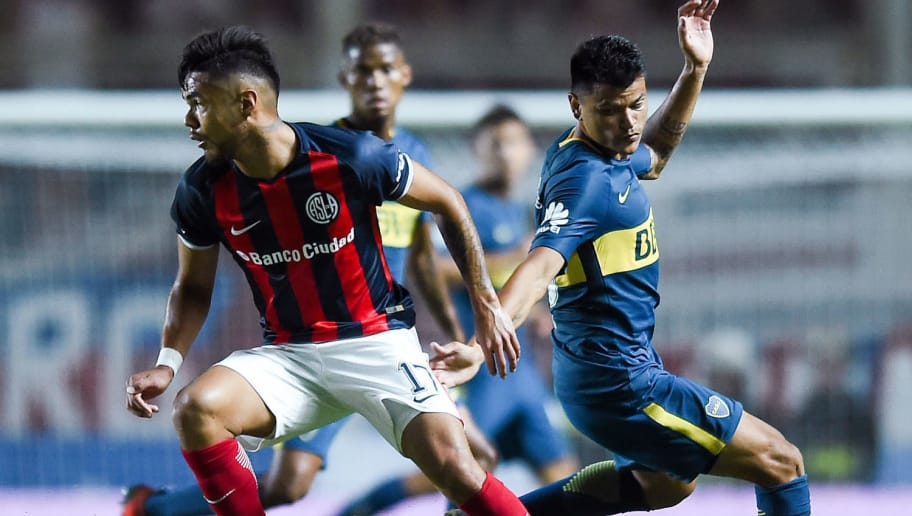 BUENOS AIRES, ARGENTINA - FEBRUARY 04: Paulo Diaz of San Lorenzo fights for ball with Walter Bou of Boca Juniors during a match between San Lorenzo and Boca Juniors as part of the Superliga  at Pedro Bidegain Stadium on February 4, 2018 in Buenos Aires, Argentina.  (Photo by Marcelo Endelli/Getty Images)