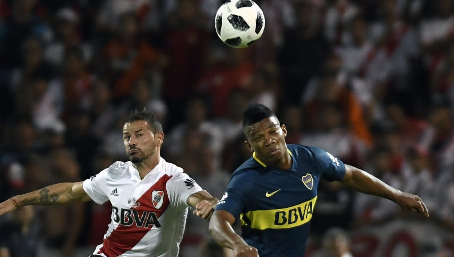 Argentina's River Plate player Rodrigo Mora (L) vies for the ball with Boca Juniors Colombian player Frank Fabra during their Supercopa Argentina 2018 football match at Malvinas Argentinas stadium in Mendoza, Argentina, on March 14, 2018. / AFP PHOTO / Andres LARROVERE        (Photo credit should read ANDRES LARROVERE/AFP/Getty Images)