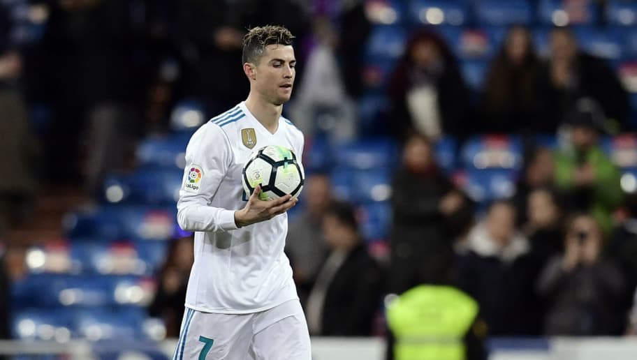 Real Madrid's Portuguese forward Cristiano Ronaldo takes the ball at the end of the Spanish League football match between Real Madrid CF and Girona FC at the Santiago Bernabeu stadium in Madrid on March 18, 2018. / AFP PHOTO / JAVIER SORIANO        (Photo credit should read JAVIER SORIANO/AFP/Getty Images)