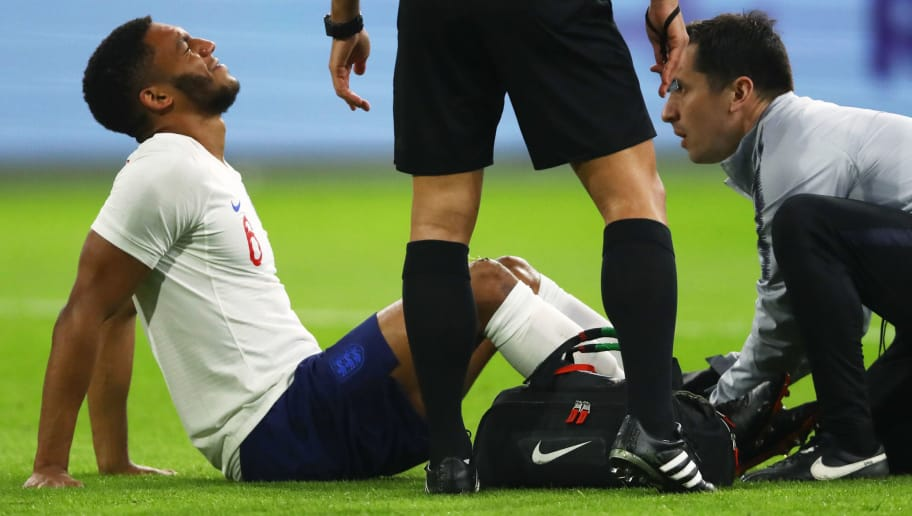 AMSTERDAM, NETHERLANDS - MARCH 23:  Joe Gomez of England is given treatment during the international friendly match between Netherlands and England at Johan Cruyff Arena on March 23, 2018 in Amsterdam, Netherlands.  (Photo by Dean Mouhtaropoulos/Getty Images)