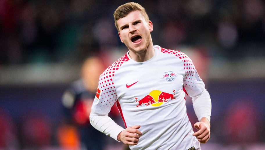 Leipzig's German forward Timo Werner celebrates scoring during the German first division Bundesliga football match between RB Leipzig and FC Bayern Munich in Leipzig, eastern Germany on March 18, 2018.  / AFP PHOTO / ROBERT MICHAEL / RESTRICTIONS: DURING MATCH TIME: DFL RULES TO LIMIT THE ONLINE USAGE TO 15 PICTURES PER MATCH AND FORBID IMAGE SEQUENCES TO SIMULATE VIDEO. == RESTRICTED TO EDITORIAL USE == FOR FURTHER QUERIES PLEASE CONTACT DFL DIRECTLY AT + 49 69 650050  / RESTRICTIONS: DURING MATCH TIME: DFL RULES TO LIMIT THE ONLINE USAGE TO 15 PICTURES PER MATCH AND FORBID IMAGE SEQUENCES TO SIMULATE VIDEO. == RESTRICTED TO EDITORIAL USE == FOR FURTHER QUERIES PLEASE CONTACT DFL DIRECTLY AT + 49 69 650050        (Photo credit should read ROBERT MICHAEL/AFP/Getty Images)